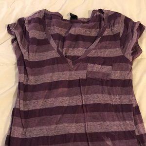 V neck purple shirt.